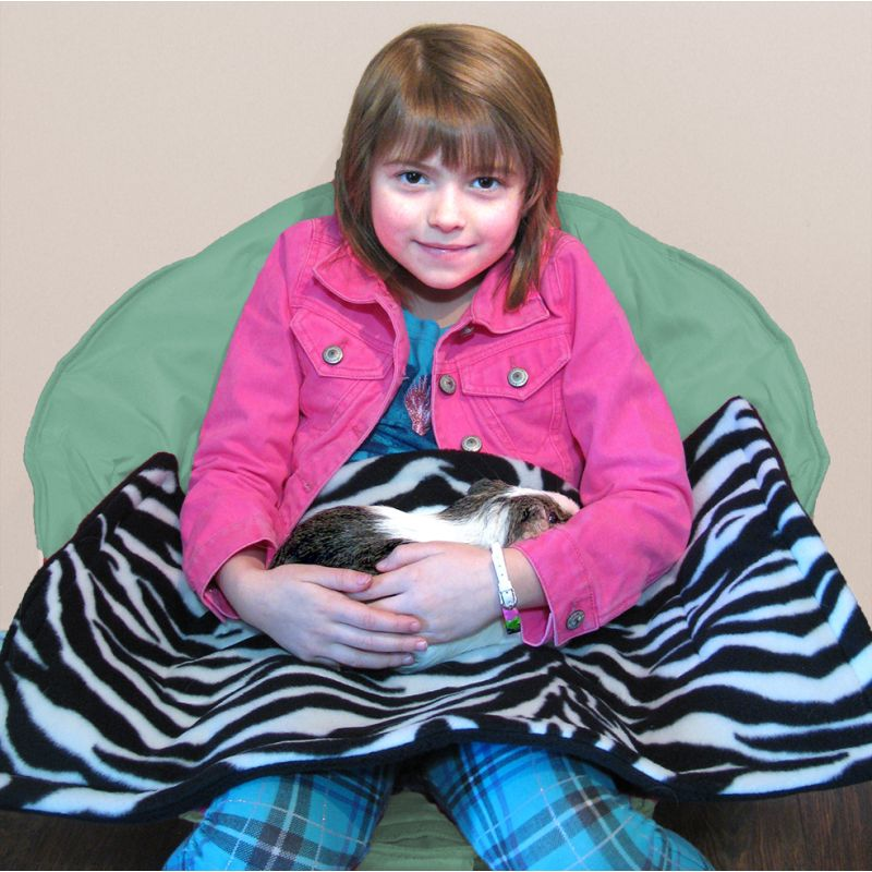 Young girl using a Lap Pad with her guinea pig